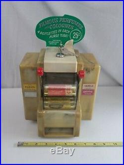 Vintage Coin Op PERFUME Dispenser Napkin holder keys Original vending machine