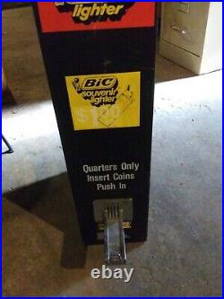 Vintage bic lighter coin operated vending machine